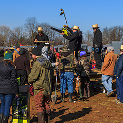 Gordonville, PA, USA / March 10, 2018: A large crowd gathers in a muddy field at the annual Lancaster County Mud Sale at the Gordonville Fire Company.