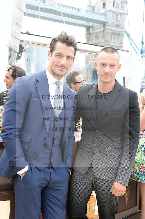 The Johnnie Walker Blue Label and David Gandy Drinks Reception aboard John Walker & Sons Voyager, St.Georges Stairs Tier, Butler's Wharf Pier, London, UK on 16th July 2013.<br /> Picture Shows:-David Gandy and Jonathan Saunders.