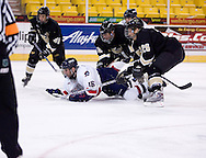 October 13, 2007 - Anchorage, Alaska: Ryan Cruthers (16) of the Robert Morris Colonials gets pushed to the ice as he sends a shot past the WSU goalie in the Colonials 4-1 victory over the Wayne State Warriors at the Nye Frontier Classic at the Sullivan Arena.
