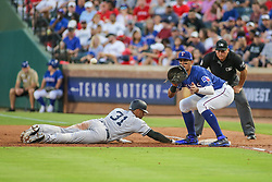 May 23, 2018 - Arlington, TX, U.S. - ARLINGTON, TX - MAY 23: New York Yankees outfielder Aaron Hicks (31) beats a pick-off throw to first base during the game between the New York Yankees and the Texas Rangers on May 23, 2018 at Globe Life Park in Arlington, TX. (Photo by George Walker/Icon Sportswire) (Credit Image: © George Walker/Icon SMI via ZUMA Press)