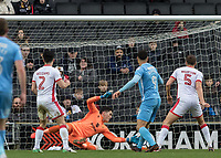 Football - 2017 / 2018 FA Cup - Fourth Round: Milton Keynes Dons vs. Coventry City<br /> <br /> Lee Nicholls (MK Dons) gets finger tips to the shot from Maxime Biamou (Coventry City) at the Stadium MK.<br /> <br /> COLORSPORT/DANIEL BEARHAM