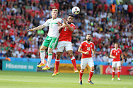 Neil Taylor of Wales jumps for a header with Steven Davis of Northern Ireland.UEFA Euro 2016, last 16 , Wales v Northern Ireland at the Parc des Princes in Paris, France on Saturday 25th June 2016, pic by  Andrew Orchard, Andrew Orchard sports photography.