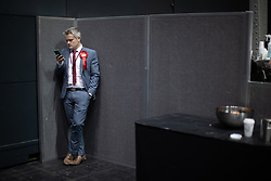 © Licensed to London News Pictures . 26/05/2019. Manchester, UK. Labour activist on his mobile phone . The count for seats in the constituency of North West England in the European Parliamentary election , at Manchester Central convention centre . Photo credit: Joel Goodman/LNP