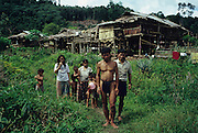 Nomadic Penan, MALAYSIA. Sarawak, Borneo, South East Asia.Baru's family group with their sulap settlement behind. 1989<br /> <br /> Tropical rainforest and one of the world's richest, oldest eco-systems, flora and fauna, under threat from development, logging and deforestation. Home to indigenous Dayak native tribal peoples, farming by slash and burn cultivation, fishing and hunting wild boar. Home to the Penan, traditional nomadic hunter-gatherers, of whom only one thousand survive, eating roots, and hunting wild animals with blowpipes. Animists, Christians, they still practice traditional medicine from herbs and plants. Native people have mounted protests and blockades against logging concessions, many have been arrested and imprisoned.