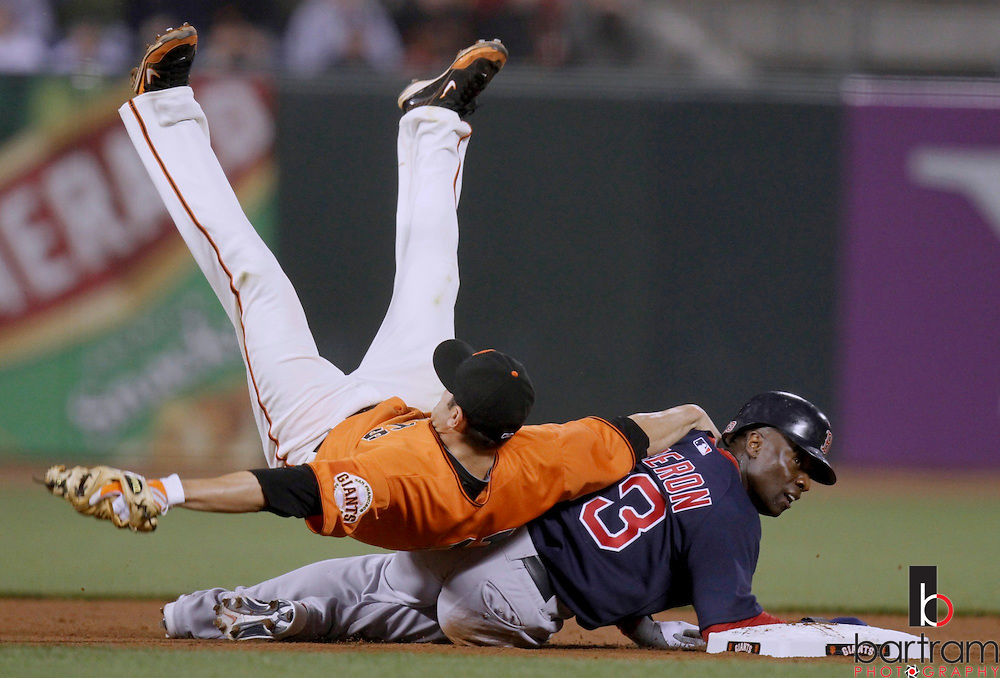 San Francisco Giants Freddy Sanchez is upended at second base by the Boston Red Sox Mike Cameron during their MLB interleague baseball game in San Francisco, California. REUTERS/Kevin Bartram