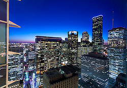 Night view of downtown skyscrapers in the Houston, Texas skyline from 811 Main Street.