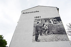 Mural painted on wall of apartment building on Ackerstrasse at Berlin Wall memorial park at Bernauer Strasse in Berlin, Germany