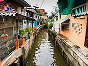 20 JULY 2015 - NONTHABURI, NONTHABURI, THAILAND:  A small khlong (canal) in Nonthaburi, a suburb of Bangkok. This area is supposed to redeveloped and the people who live here may be evicted to make for the redevelopment. The Chao Phraya promenade is development project of parks, walkways and recreational areas on the Chao Phraya River between Pin Klao and Phra Nang Klao Bridges. The 14 kilometer long promenade will cost approximately 14 billion Baht (407 million US Dollars). The project involves the forced eviction of more than 200 communities of people who live along the river, a dozen riverfront  temples, several schools, and privately-owned piers on both sides of the Chao Phraya River. Construction is scheduled on the project is scheduled to start in early 2016. There has been very little public input on the planned redevelopment.          PHOTO BY JACK KURTZ