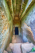 Domos (entrance corridor) to an Etruscan tumulus tomb cut into Tuff volcanic rock known as the Tomba del Cornice, 6th century BC, Necropoli della Banditaccia, Cerveteri, Italy. A UNESCO World Heritage Site .<br /> <br /> Visit our ETRUSCAN PHOTO COLLECTIONS for more photos to buy as buy as wall art prints https://funkystock.photoshelter.com/gallery-collection/Pictures-Images-of-Etruscan-Historic-Sites-Art-Artefacts-Antiquities/C0000GgxRXWVMLyc