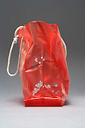 side view of a plastic shopping bag with snow stars decoration