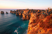 PORTUGAL, ALGARVE, SOUTH COAST Ponta de Piedade, rocky peninsula with lighthouse jutting into the sea just south of Lagos