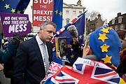 Anti Brexit pro Europe demonstrators speak with Luke Pollard, British Labour Co-operative politician in Westminster opposite Parliament on the day MPs vote on EU withdrawal deal amendments on 29th January 2019 in London, England, United Kingdom.