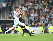 Casemiro against Christian Eriksen during the Champions League match between Real Madrid and Tottenham Hotspur at the Santiago Bernabeu Stadium, Madrid, Spain on 17 October 2017. Photo by Ahmad Morra.
