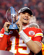 Kansas City Chiefs quarterback Patrick Mahomes holds the Lamar Hunt Trophy as he celebrates winning a NFL, AFC Championship football game against the Tennessee Titans, Sunday, Jan. 19, 2020, in Kansas City, MO. The Chiefs won 35-24 to advance to Super Bowl 54. (AP Photo/Colin E. Braley)