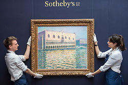 """© Licensed to London News Pictures. 20/02/2019. LONDON, UK. Technicians hold """"Le Palais Ducal"""", 1908, by Claude Monet (Est. £20-30m). Preview of Sotheby's Impressionist & Modern and Surrealist Art sales.  The auction will take place at Sotheby's New Bond Street on 26 February 2019.  Photo credit: Stephen Chung/LNP"""