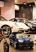 Luxury cars, real and toy, in a showroom in the Downtown area of Beirut, Lebanon