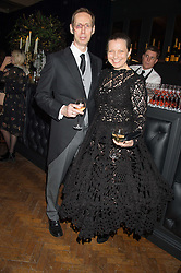 NICK KNIGHT and his wife CHARLOTTE at the Veuve Clicquot Widow Series launch party hosted by Nick Knight and Jo Thornton MD Moet Hennessy UK held at The College, Central St.Martins, 12-42 Southampton Row, London on 29th October 2015.