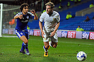 Leeds United's Charlie Taylor goes past Cardiff City's Fabio Da Silva. Skybet football league championship match, Cardiff city v Leeds Utd at the Cardiff city stadium in Cardiff, South Wales on Tuesday 8th March 2016.<br /> pic by Carl Robertson, Andrew Orchard sports photography.