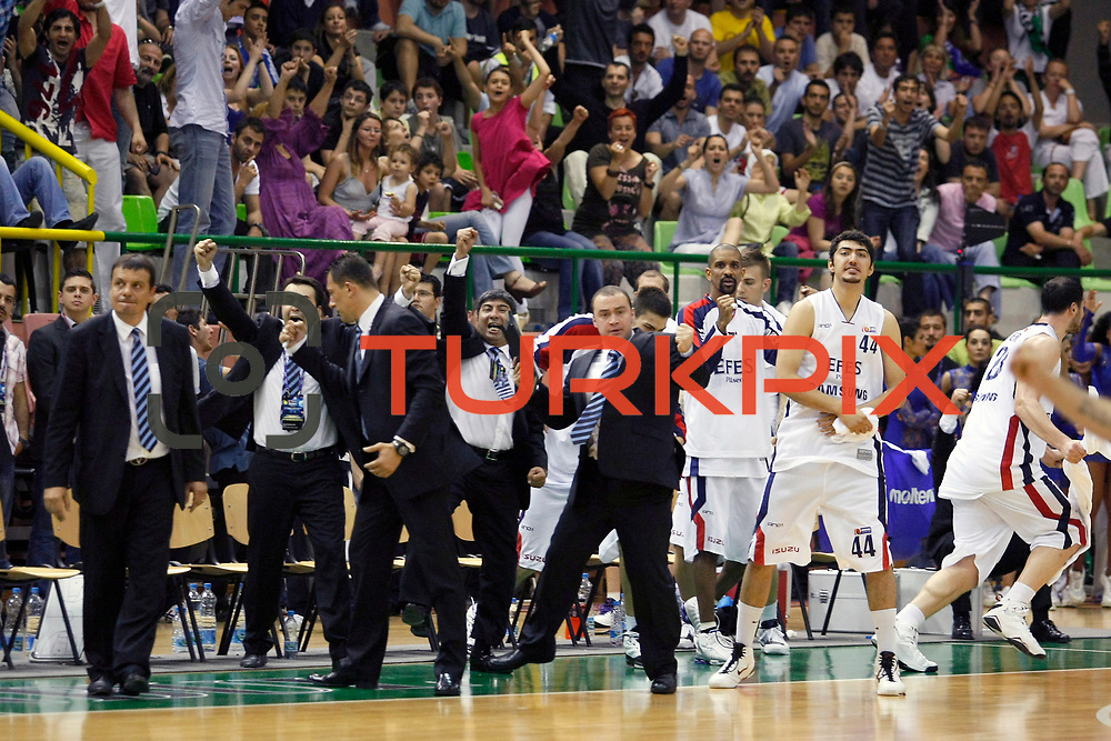 Efes Pilsen's coach Ergin ATAMAN (L) Preston SHUMPERT (2ndR) Ali ISIK (R) celebrate victory during their Turkish Basketball league Play Off Final fifth leg match Efes Pilsen between Fenerbahce Ulker at the Ayhan Sahenk Arena in Istanbul Turkey on Sunday 30 May 2010. Photo by Aykut AKICI/TURKPIX