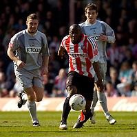 Photo: Alan Crowhurst.<br />Brentford v Bradford City. Coca Cola League 1. 08/04/2006. Isaiah Rankin bursts through for Brentford.