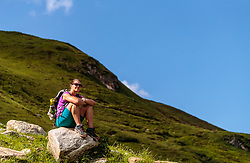 THEMENBILD - eine Frau sitzt auf einem Stein in der Sonne, aufgenommen am 15. Juni 2017, Kaprun, Österreich // A woman sitting on a stone in the sun on 2017/06/15, Kaprun, Austria. EXPA Pictures © 2017, PhotoCredit: EXPA/ JFK