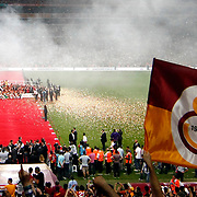 Galatasaray players celebrate with the trophy after their Turkish Super League soccer match against Trabzonspor at Turk Telekom Arena stadium May 18, 2013.Galatasaray won the Turkish league title for the 19th time. Photo by Aykut AKICI/TURKPIX