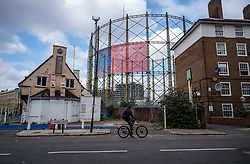 Licensed to London News Pictures. 20/09/2021. London, UK. The iconic Oval Gasholders which were built in 1853 looms over homes in Kennington, south-east London as the wholesale price of gas continues to soar, leading to empty shelves in supermarkets and price rises for millions of homeowners in the coming winter months. Gas prices have soared over the last few months with Downing Street planing to offer emergency loans to struggling energy companies amid fears they could collapse. Photo credit: Alex Lentati/LNP