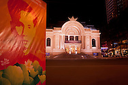 Propaganda in front of the opera and cityscape at night on Dong Khoi Street, Ho Chi Minh city, Vietnam, Asia