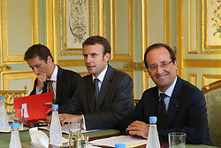 French president Francois Hollande flanked by his economic advisor Emmanuel Macron receives European Union president Herman Van Rompuy to a meeting at the Elysee presidential palace, in Paris, France on September 5, 2012. Photo by Stephane Lemouton/ABACAPRESS.COM