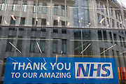 Ten weeks after the UK went into Coronavirus pandemic lockdown, the Office for National Statistics reveal that the total death toll has passed 50,000 covid-19 victims, a large banner thanking and supporting NHS National Health Service key workers, is outside newly-completed offices in the City of London, the capitals financial district, on 2nd June 2020, in London, England.