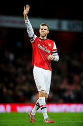 Arsenal Defender Per Mertesacker (GER) waves to the supporters after Arsenal win the match 2-0 - Photo mandatory by-line: Rogan Thomson/JMP - Tel: Mobile: 07966 386802 - 18/01/14 - SPORT - FOOTBALL - Emirates Stadium - Arsenal v Fulham - Barclays Premier League.