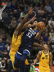 April 1, 2018 - Minneapolis, MN, USA - Minnesota Timberwolves center Karl-Anthony Towns (32) is defended as he drives the hoop in the first half by Utah Jazz forward Derrick Favors (15) on Sunday, April 1, 2018 at Target Center in Minneapolis, Minn. Towns finished with 20 points. (Credit Image: © Jeff Wheeler/TNS via ZUMA Wire)