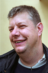 Portrait of man with learning disability laughing,