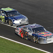 The beat up cars of Sprint Cup Series driver Brian Vickers (83) and Sprint Cup Series driver Jimmie Johnson (48) come down pit road during the Daytona 500 at Daytona International Speedway on February 20, 2011 in Daytona Beach, Florida. (AP Photo/Alex Menendez)