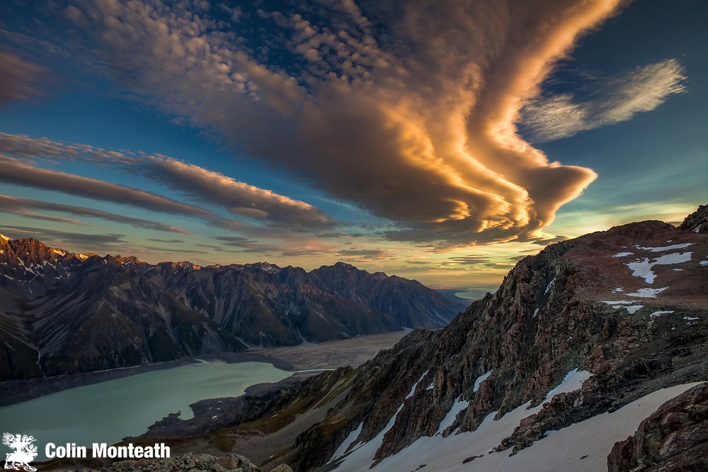 Wind clouds at dusk over Tasman Glacier Valley, from summit Mt Kinsey, Aoraki Mount Cook National Park, Canterbury New Zealand