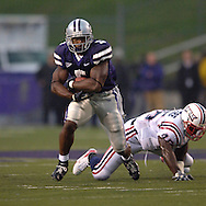 Kansas State running back Thomas Clayton (5) rushes past Florida Atlantic linebacker Cergile Sincere (45) in the first half at Bill Snyder Family Stadium in Manhattan, Kansas, September 9, 2006.  The Wildcats beat the Owls 45-0.