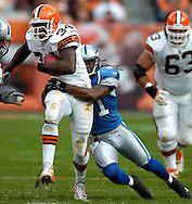 MORNING JOURNAL/DAVID RICHARD.Reuben Droughns of Cleveland drags Detroit's R. W. McQuarters on a run in the second quarter yesterday.