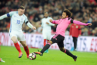 Football - 2016 / 2017 World Cup Qualifier - Group F: England vs. Scotland<br /> <br /> Ikechi Anya of Scotland and Wayne Rooney of England at Wembley.<br /> <br /> COLORSPORT/ANDREW COWIE