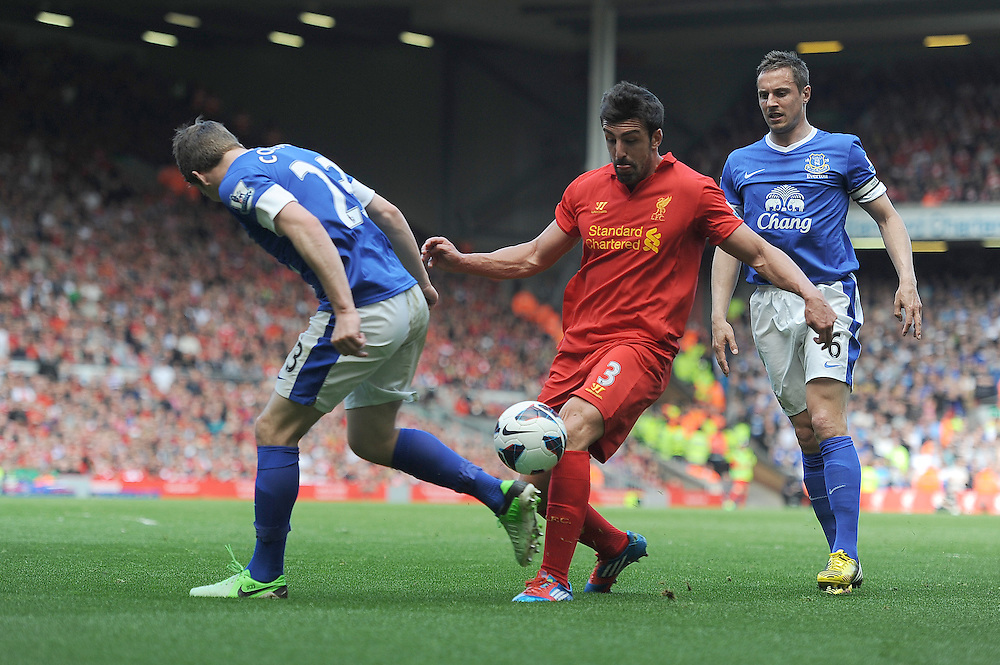 Liverpool's Jose Enrique takes on Everton's Seamus Coleman .. - (Photo by Stephen White/CameraSport) - ..Football - Barclays Premiership - Liverpool v Everton - Sunday 5th May 2013 - Anfield - Liverpool..© CameraSport - 43 Linden Ave. Countesthorpe. Leicester. England. LE8 5PG - Tel: +44 (0) 116 277 4147 - admin@camerasport.com - www.camerasport.com