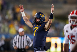 Sep 8, 2018; Morgantown, WV, USA; West Virginia Mountaineers quarterback Will Grier (7) celebrates a touchdown during the third quarter against the Youngstown State Penguins at Mountaineer Field at Milan Puskar Stadium. Mandatory Credit: Ben Queen-USA TODAY Sports
