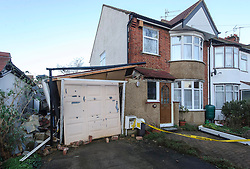 © Licensed to London News Pictures. 13/01/2015 Harrow, UK. A view of the damage to a garage in Harrow NW London after a  mini-tornado ripped apart the property in what firefighters described as 'like a scene from The Wizard of Oz' as Britain was on snow and flood alert. Photo credit : Simon Jacobs/LNP