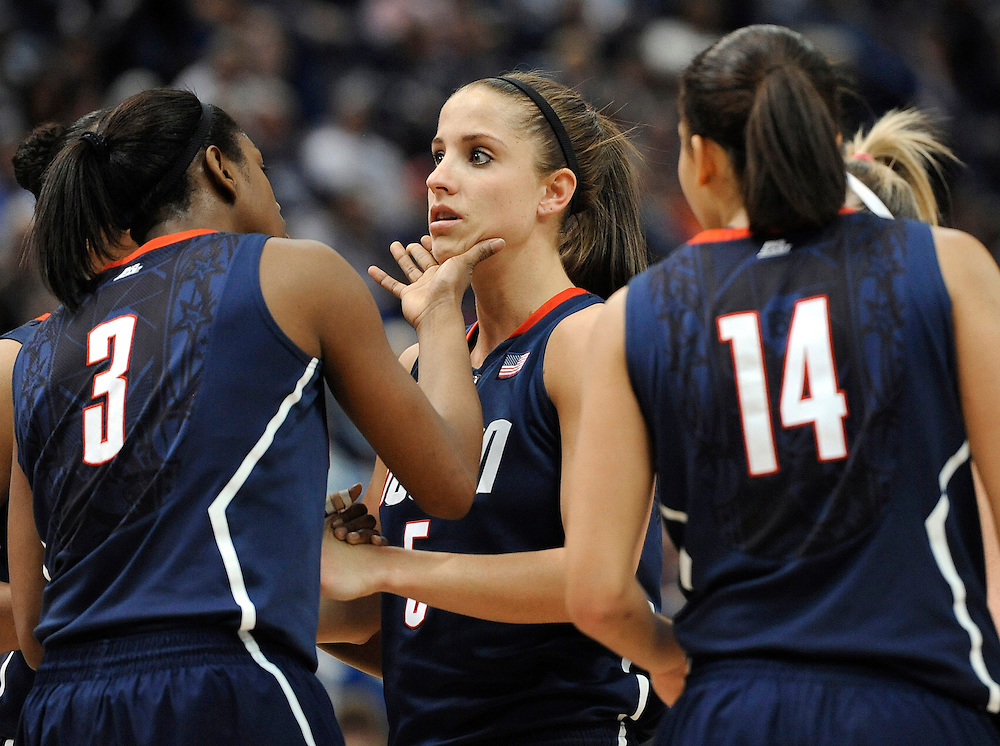 Connecticut's Tiffany Hayes (3) and Bria Hartley (14) check on player Caroline Doty, center, after Doty took a hard fall on the court in the second half of an NCAA college basketball game against Notre Dame in the finals of the Big East women's tournament in Hartford, Conn., Tuesday, March 6, 2012.  (AP Photo/Jessica Hill)
