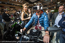 A virtual accessory on display in the Kawasaki booth during EICMA, the largest international motorcycle exhibition in the world. Milan, Italy. November 20, 2015.  Photography ©2015 Michael Lichter.