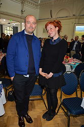 TOM BARTLETT and KATE ROTHSCHILD at a lunch in aid of the charity African Solutions to African Problems (ASAP) held at the Royal Horticultural Hall, Vincent Square, London on 19th May 2016.