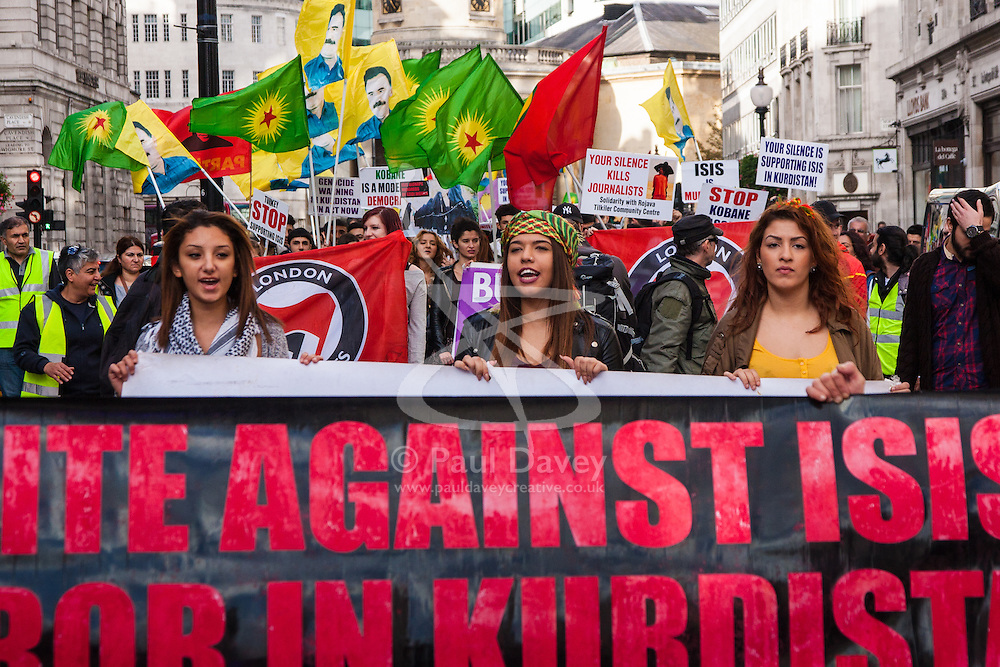 London, October 19th 2014. Hundreds of London's Kurdish community march throgh the capital in protest against ISIS and the Turkish government who they accuse, by not getting involved in military action against ISIS, of using the Jihadists to wipe out Kurds who have long been campaigning for an independent Kurdistan. PICTURED: Protesters march along Regents Street.
