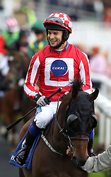 Love Island's Chris Hughes rides Carnageo before The Best Western Hotels & Macmillan Ride of their Lives, during the Macmillan Charity Raceday at York Racecourse.