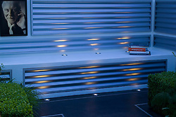 Corrugated steel walls with bench seat and uplighting at dusk. Photographs by Patrick Litchfield. The Gallery Outside. Design: Marcus Barnett and Philip Nixon - Chelsea 2005