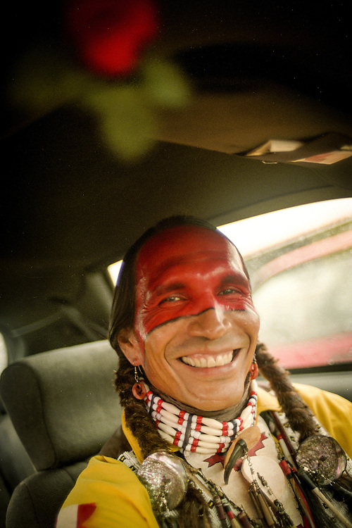 Tommy Christian, Assiniboine Sioux dancer, waiting out the rain at Schemitzun, a powwow in North Stonington, Connecticut, on the Mashantucket Pequot reservation in 1996.