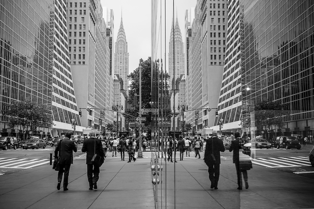 Photo of a street reflection on windows at 42nd street with the Chrysler Building in the background, New York