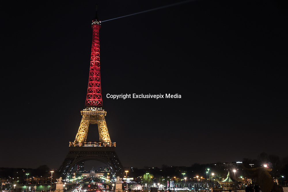 Mar 22, 2016 - Paris, France - The Eiffel tower lit with the colours of the Belgian flag in memory of the terror attack in Brussels<br />  (Credit Image: © Exclusivepix Media)